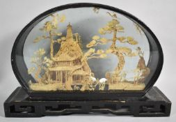 An Oriental Cased Intricately Carved Cork wood Diorama Depicting Storks, Trees and Pagoda, Plinth