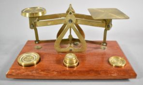 A Reproduction Brass Set of Postage Scales with Weights on Wooden Plinth, 18cm wide