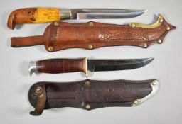 Two Finnish Hunting Knives both with Leather Scabbards, One with Blade Inscribed for Tisakki Var