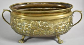 An Oval Brass Planter with Repousse Decoration of Grapes and Vine Leaves, 30.5cm wide