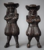 A Pair of Carved Wooden Dutch Cigar Indians in the Form of Long Haired Gents with Hats, Crossed