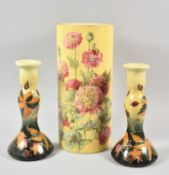 A Pair of Ceramic Candle Sticks and Cylindrical Floral Decorated Vase, 30.5cm high