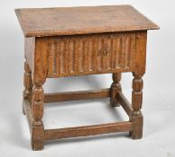 A Oak Peg Jointed Box Stool with Carved Front Panel and Turned Reeded Supports, Hinged Lid, 47.5cm