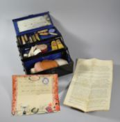A Vintage Metal Cantilevered Actors Makeup Box with Stage Makeup, Powders, Plus Typewritten Guide