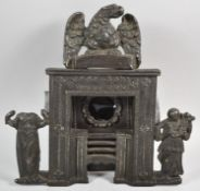 A Late 19th Century Cast Iron Pocket Watch Holder in the Form of a Cooking Range, One Side Figure