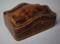 An Unusual Florentine Pressed Pigskin Box with Hinged Shaped Lid Having Gilt Decoration, 10cm wide
