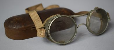 A Metal Cased Pair of Vintage Goggles