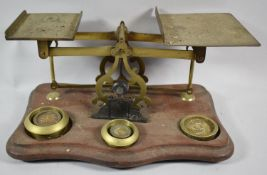 A Set of Early 20th Century Brass Postage Scales on Serpentine Front Wooden Plinth, Some Weights but
