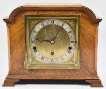 An Edwardian Walnut Cased Westminster Chime Mantle Clock by Elliot, 30cm wide