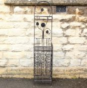 A Wrought Metal Wine Rack Stand