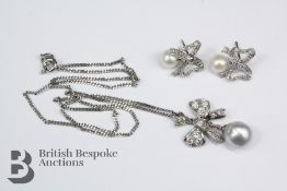 14/15ct White Gold Pearl and Diamond Bow Pendant and Earrings