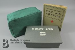 A Vintage American Red Cross First Aid Textbook and Metal First Aid Kit
