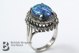 A White Metal and Synthetic Black Opal Ring