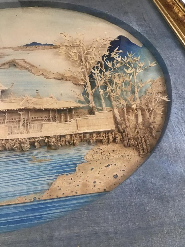 Lot 557 - A FRAMED AND GLAZED ORIENTAL CORK PICTURE OF A PALACE AND SEASCAPE, H47CM X W47CM