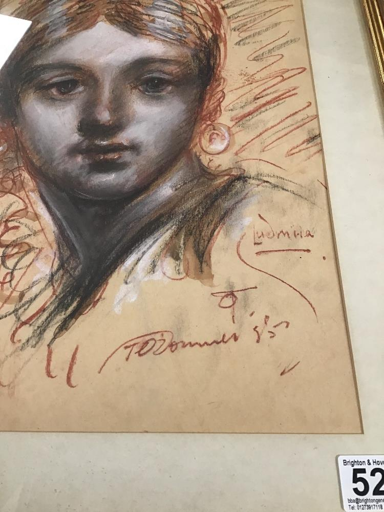 Lot 526 - TOM O'DONNELL, A FRAMED AND GLAZED SANGUINE AND CHARCOAL POTRTRAIT OF A GIRL WITH EARRINGS