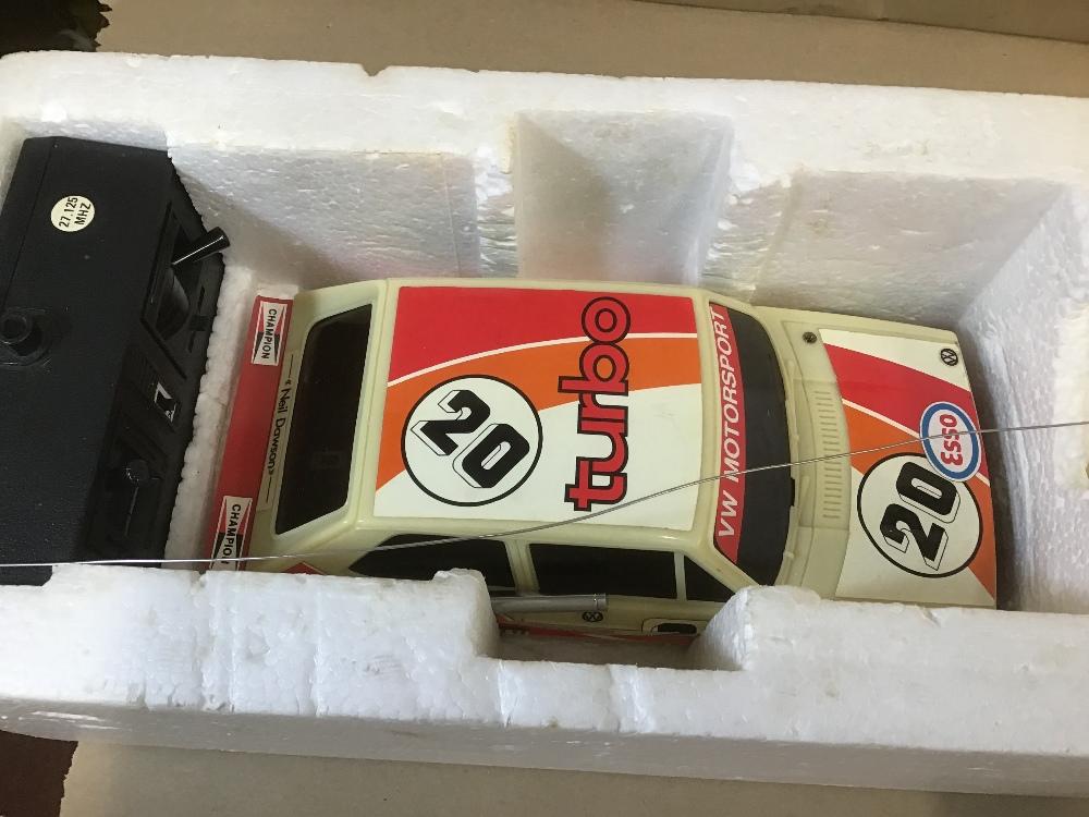Lot 10 - A CORGI VW GOLF RADIO CONTROLLED TURBO RALLY CAR IN ORIGINAL BOX