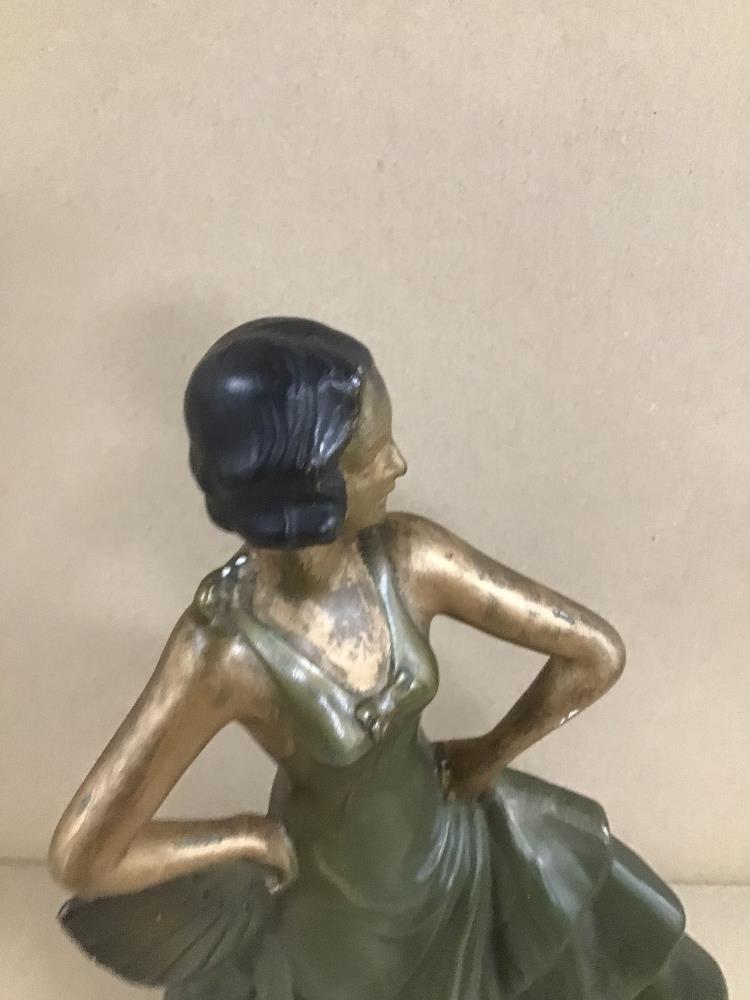 Lot 22 - AN ART DECO PLASTER FIGURE OF A DANCING LADY HOLDING A HAND FAN, 32CM HIGH