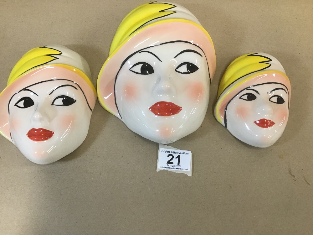 Lot 21 - A SET OF THREE GRADUATING CROWN DEVON CERAMIC WALL PLAQUES IN THE FORM OF FEMALE FACES, HAND PAINTED