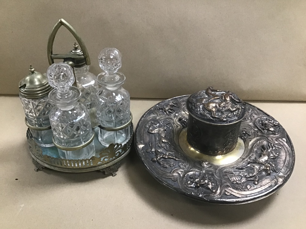 Lot 18 - A SILVER PLATE AND GLASS FOUR PIECE CRUET SET, TOGETHER WITH AN ORNATE SILVER PLATE INKWELL STAND