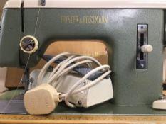 A LARGE FRISTER & ROSTMAN SEWING MACHINE, IN ORIGINAL CASE