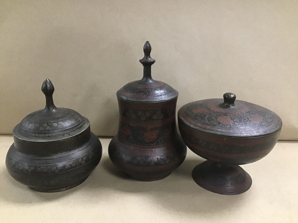 Lot 23 - THREE MIDDLE EASTERN BRASS POTS WITH BLACK ENAMEL DECORATION