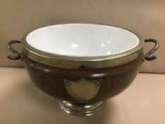 AN OAK ICE BUCKET/BOWL WITH CERAMIC LINING OF CIRCULAR FORM, SILVER PLATE MOUNTS
