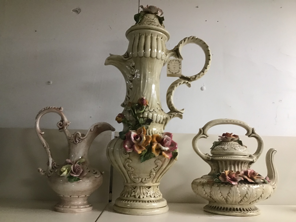 Lot 14 - AN UNUSUALLY LARGE CAPODIMONTE COFFEE POT, 65CM HIGH, TOGETHER WITH A TEAPOT AND A MILK JUG
