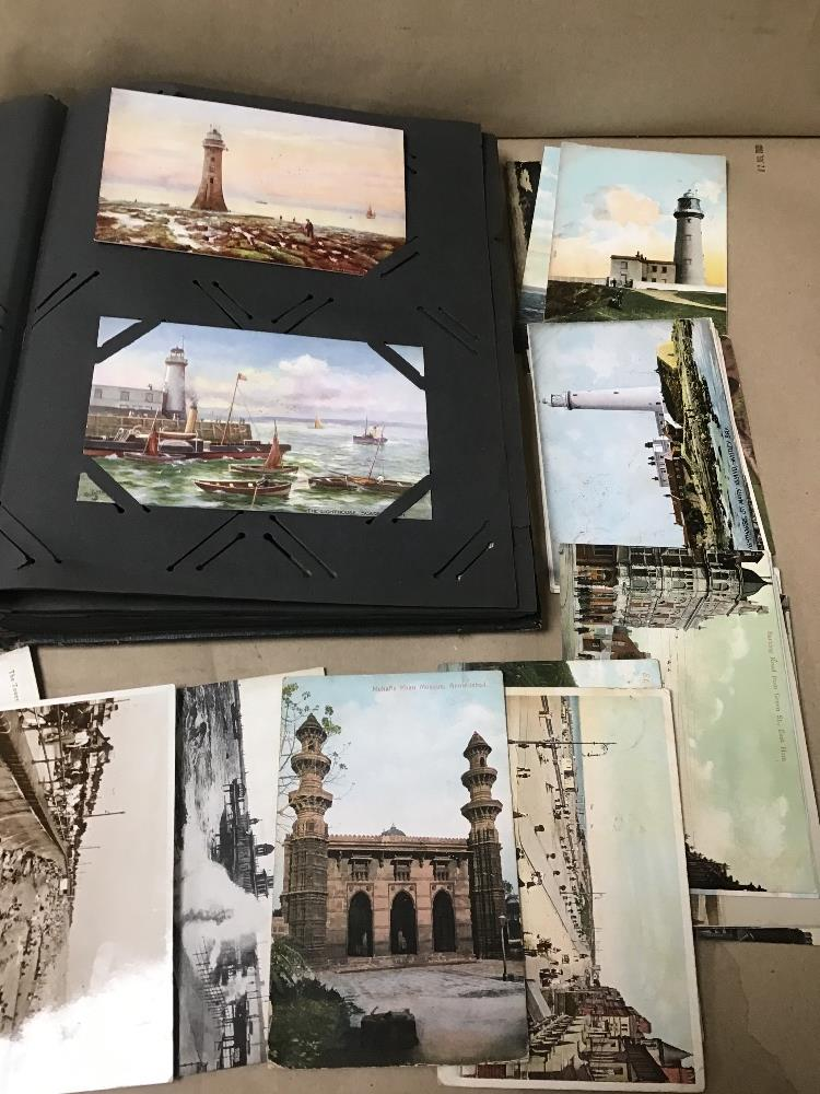 Lot 21 - A COLLECTION OF VINTAGE POSTCARDS SOME IN ALBUM, SOME LOOSE MANY OF THEM ARE OF LIGHTHOUSES