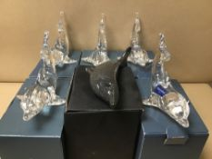 FOUR BOXED GLASS VILLEROY AND BOCH DOLPHINS WITH TWO BOXED CRYSTAL LANGHAM GLASS DOLPHINS