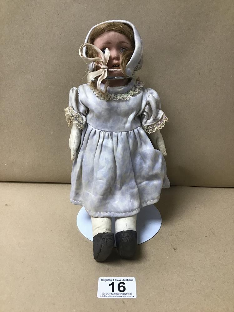 A VINTAGE DOLL ON STAND NUMBERED TO NECK 68-5