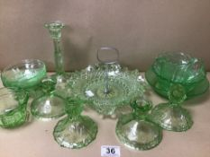 A COLLECTION OF GREEN GLASSWARE INCLUDING CANDLESTICKS, CAKE STAND ETC