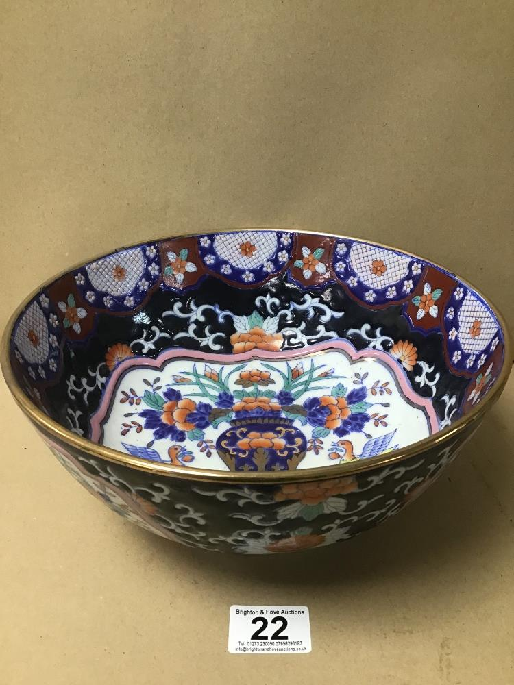 AN ORIENTAL CERAMIC BOWL OF CIRCULAR FORM, DECORATED THROUGHOUT WITH POLY-CHROME ENAMELS,