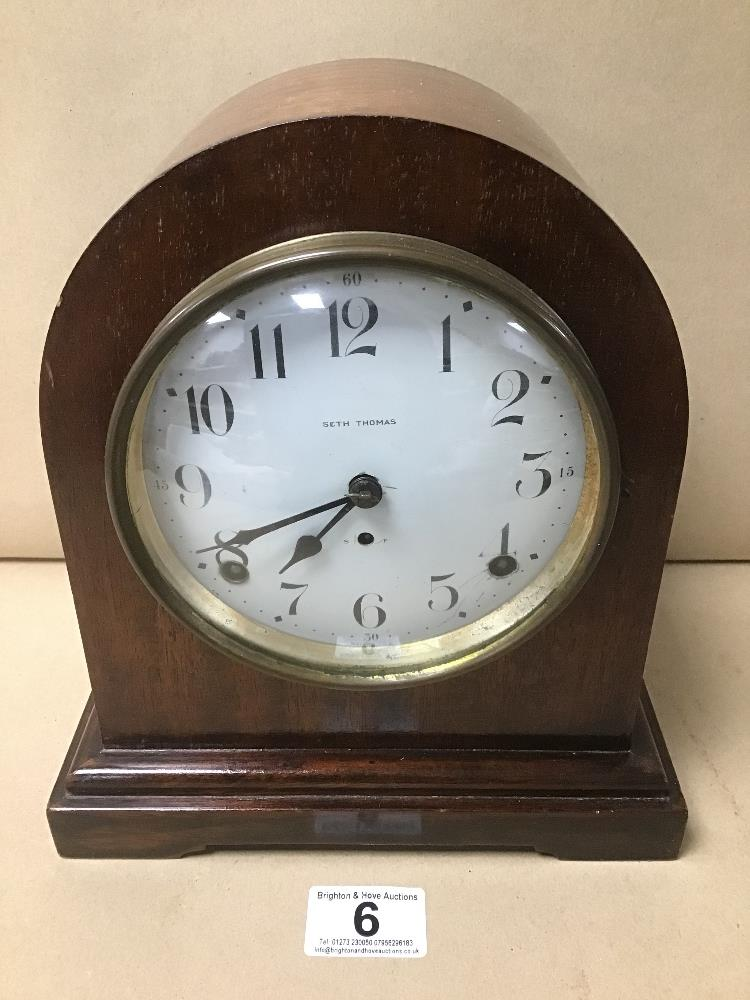 A MAHOGANY CASED MANTLE CLOCK BY SETH THOMAS, THE ENAMEL DIAL WITH ARABIC NUMERALS DENOTING HOURS,
