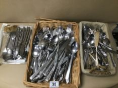 A LARGE QUANTITY OF MOSTLY STAINLESS STEEL AND SOME PLATED FLATEWARE, KNIVES FORKS ETC
