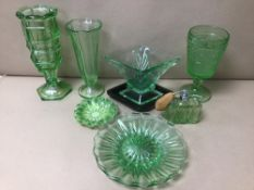 AN ASSORTMENT OF GREEN COLOURED GLASSWARE, INCLUDING VASES, ATOMIZER AND MORE