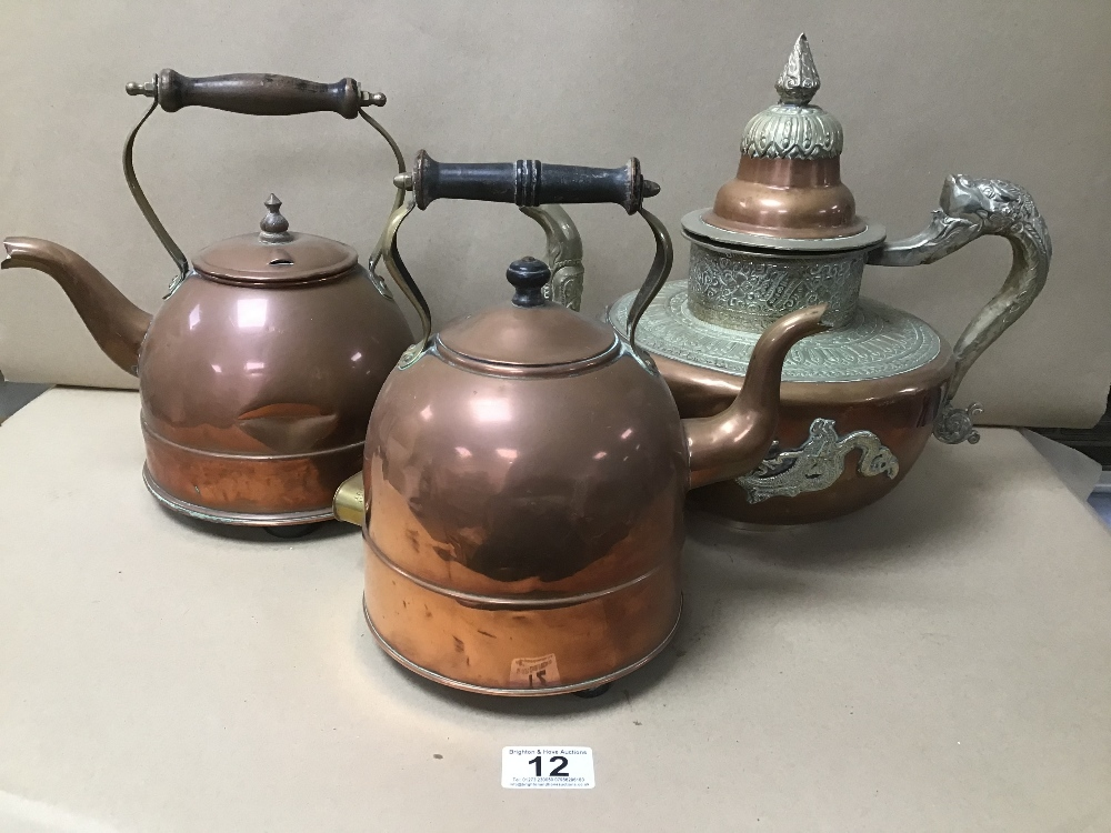 TWO EARLY COPPER AND BRASS KETTLES BY ELEXCEL AND CREDA, TOGETHER WITH AN ORIENTAL TEA POT
