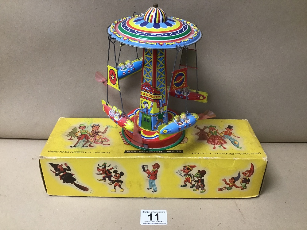 A VINTAGE PELHAM PUPPET OF A CAT, IN ORIGINAL BOX, TOGETHER WITH A TIN PLATE FAIRGROUND TOY