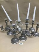 A QUANTITY OF PLATED CANDLESTICKS AND CANDELABRAS