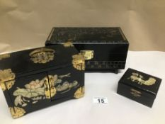 THREE BLACK LACQUERED JEWELLERY BOXES WITH MOTHER IN PEARL AND DECORATED WITH ANIMALS AND RIVER