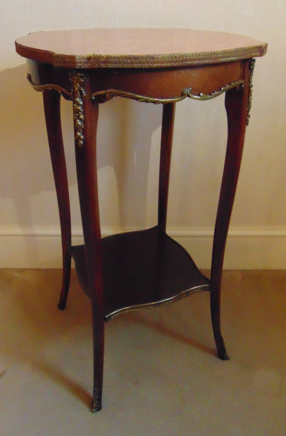 Lot 17 - A mahogany side table of shaped rectangular form with marble top and cabriole legs