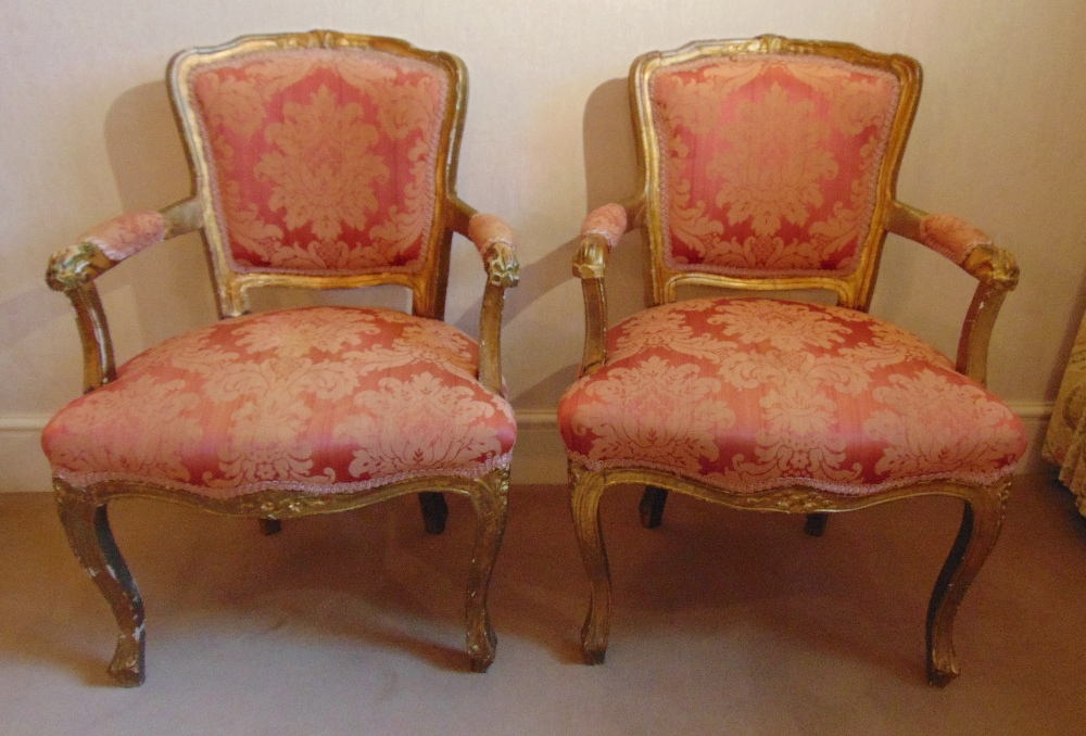 Lot 31 - A pair of French style upholstered bedroom armchairs on cabriole legs