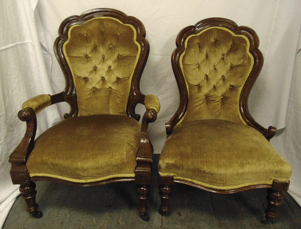 Lot 34 - Two Victorian mahogany button back upholstered chairs on four turned legs