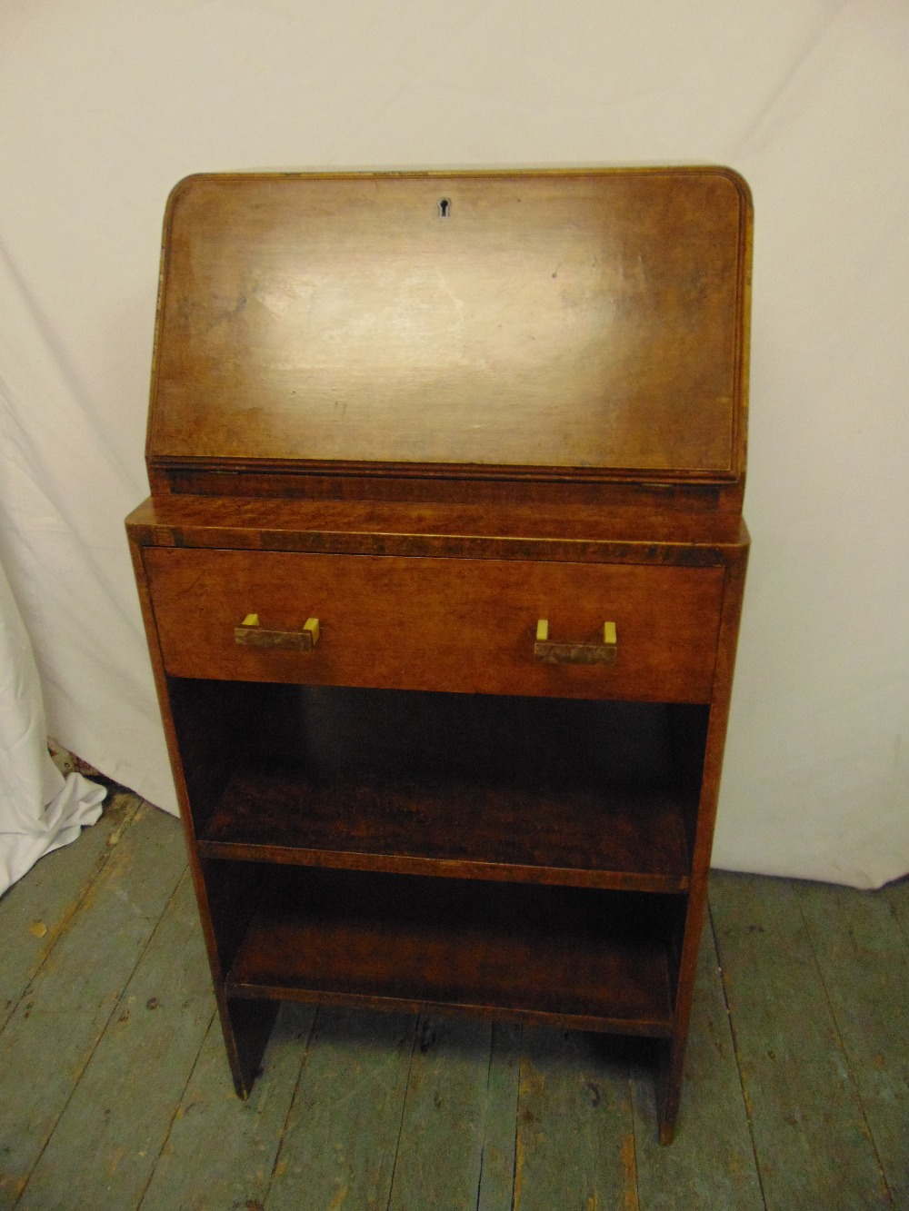 Lot 4 - An Art Deco burr maple rectangular bureau with hinged desk pad opening to reveal fitted interior