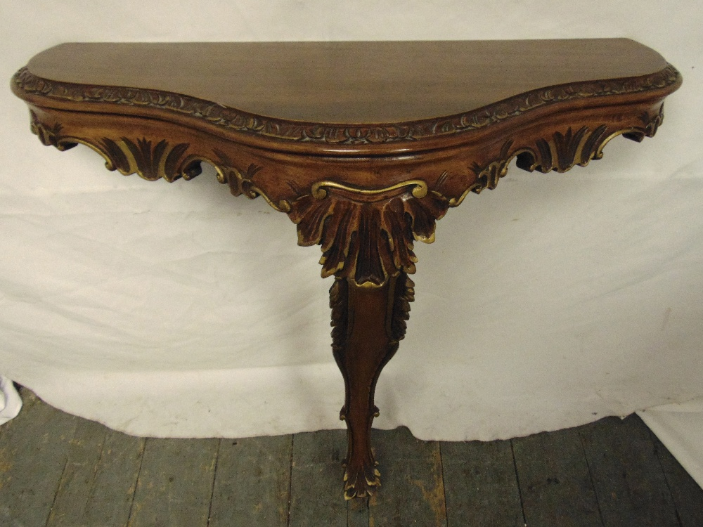 Lot 14 - A mahogany demilune wall mounted console table