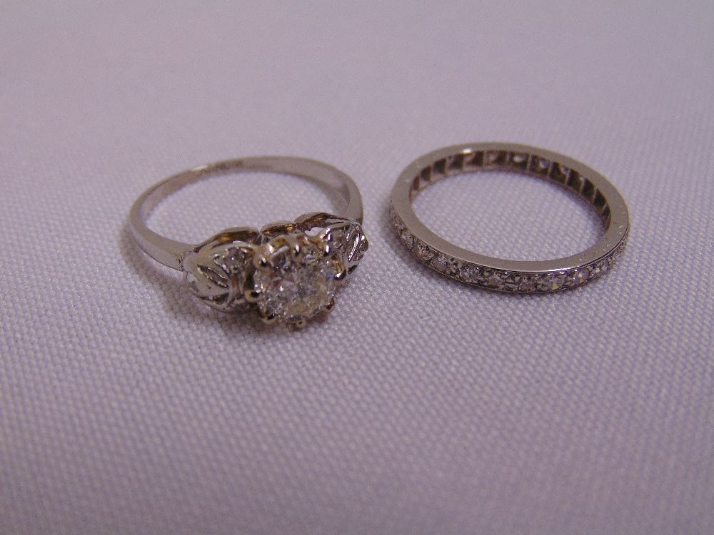 Lot 352 - A white gold and diamond eternity ring and a platinum and diamond dress ring, approx total weight