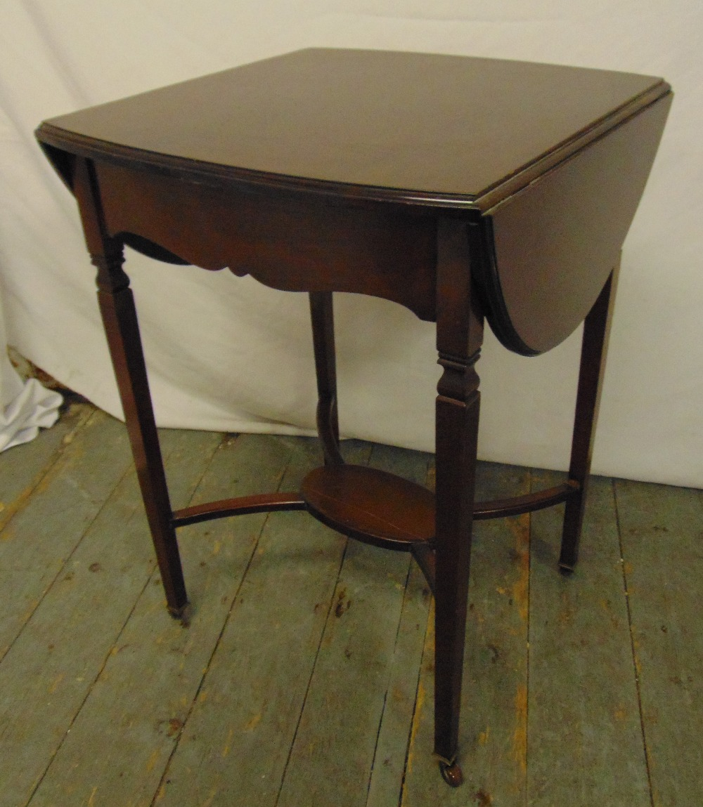 Lot 20 - An Edwardian mahogany rectangular drop flap tea table on tapering legs