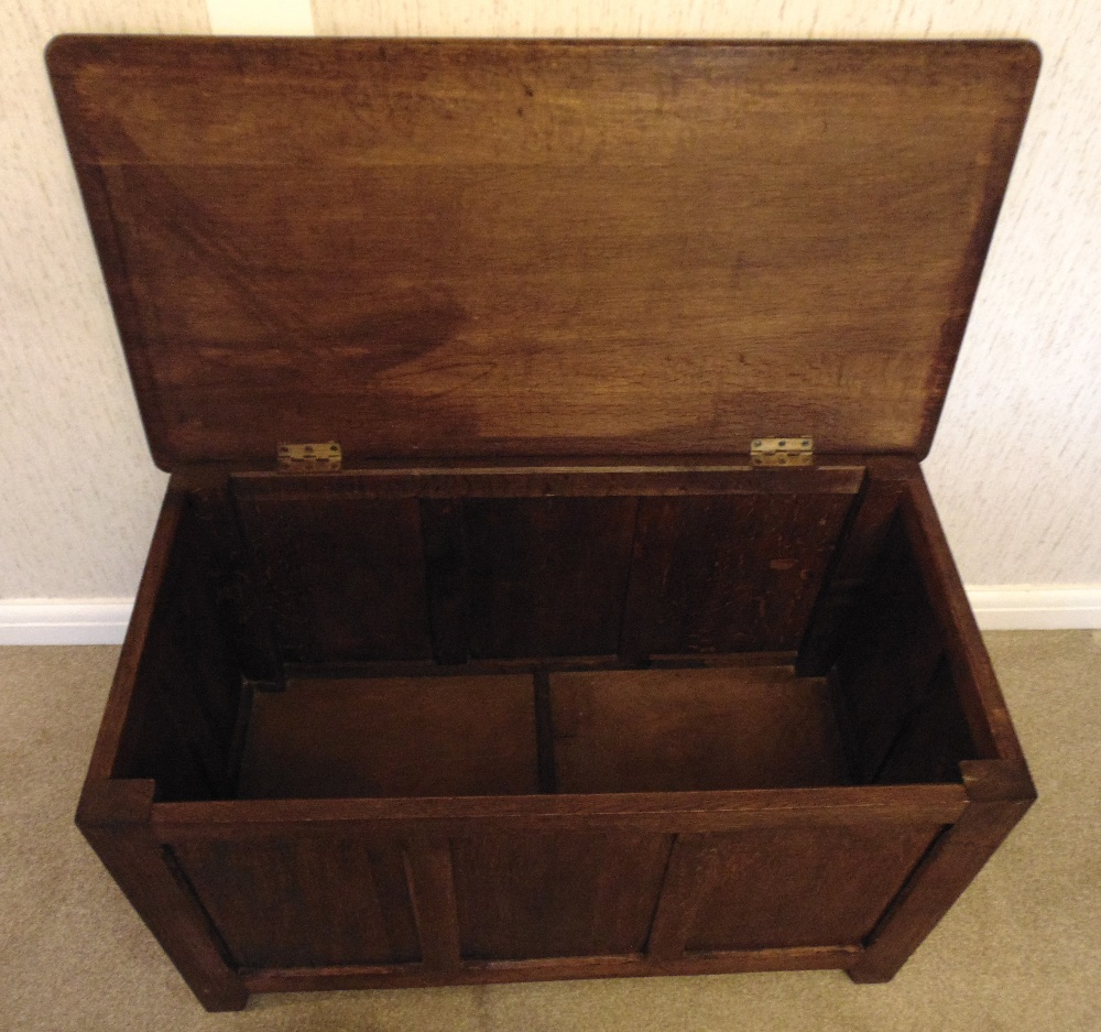 Lot 24 - An oak rectangular blanket box with hinged cover, on bracket feet
