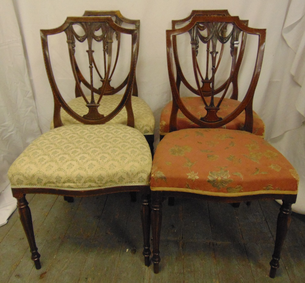 Lot 30 - Four Edwardian mahogany dining chairs with pierced shield backs, on tapering cylindrical legs