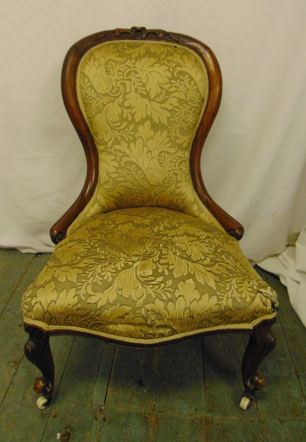 Lot 35 - A Victorian mahogany upholstered balloon back chair on scroll legs with original castors