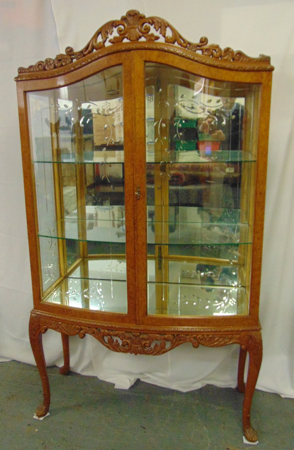 Lot 8 - An Epstein bow fronted rectangular glazed display cabinet with scroll pierced top on cabriole legs